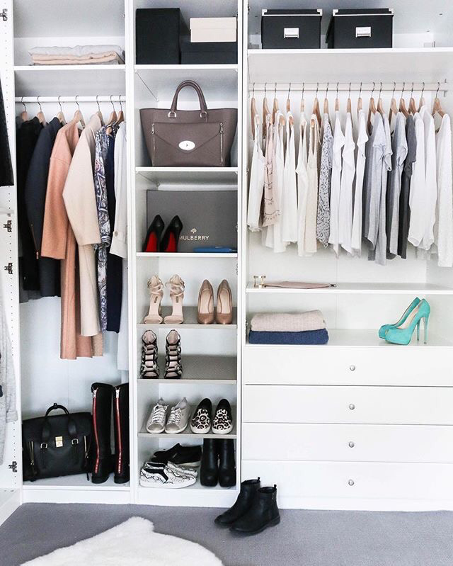 Women's wardrobe, tidy with white shelves, neutral co,lured clothes and pale green shoes